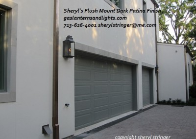 Sheryl's Flush Mount Gas Lanterns by Garage Doors