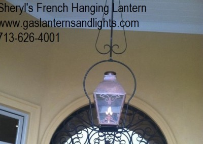 Sheryl's French Hanging Lantern with Solid Top and Scroll in Window Pane