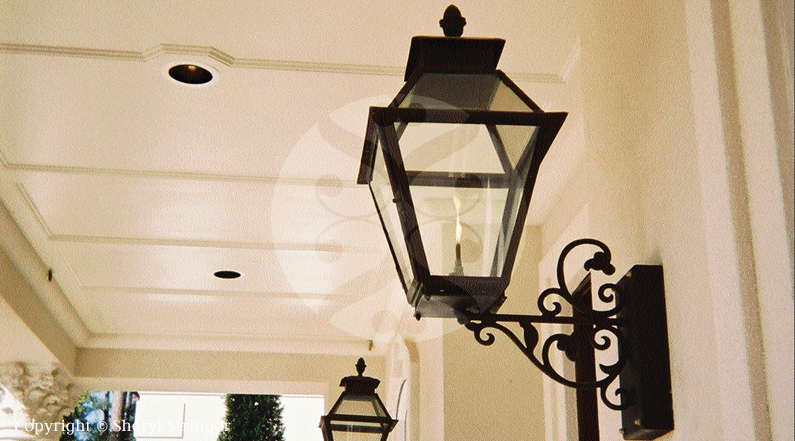 46.  V Style Lantern with Scroll Bracket